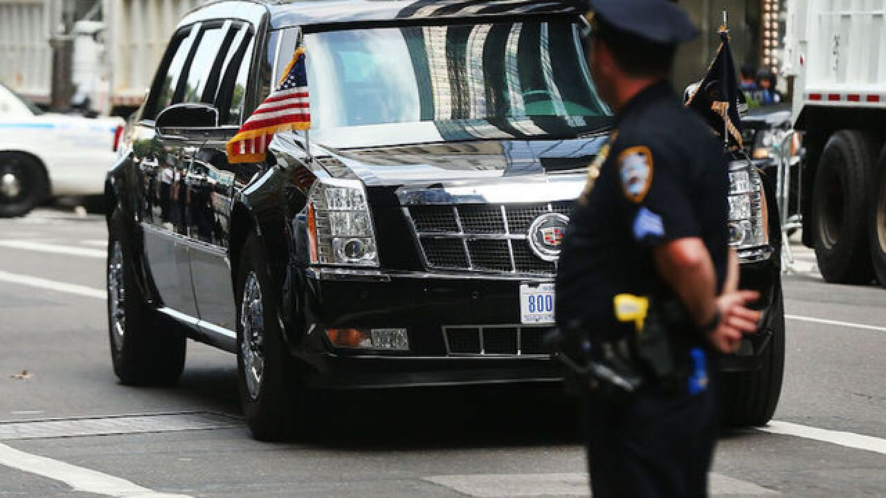 Woman who claims she was fired for flipping off Trump motorcade sues former employer