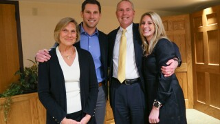 Marcia and Bill Roeser pose with their children, Rob and Julia, at this week's retirement reception.