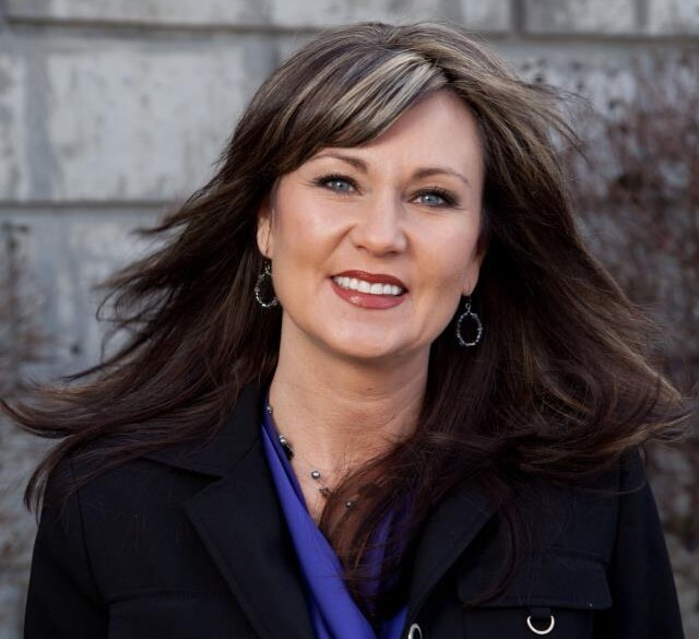 Leisa Spears Mulcahy is vice president of workforce at the Northern Kentucky Chamber of Commerce. In this portrait, she is wearing a blue top and black coat.