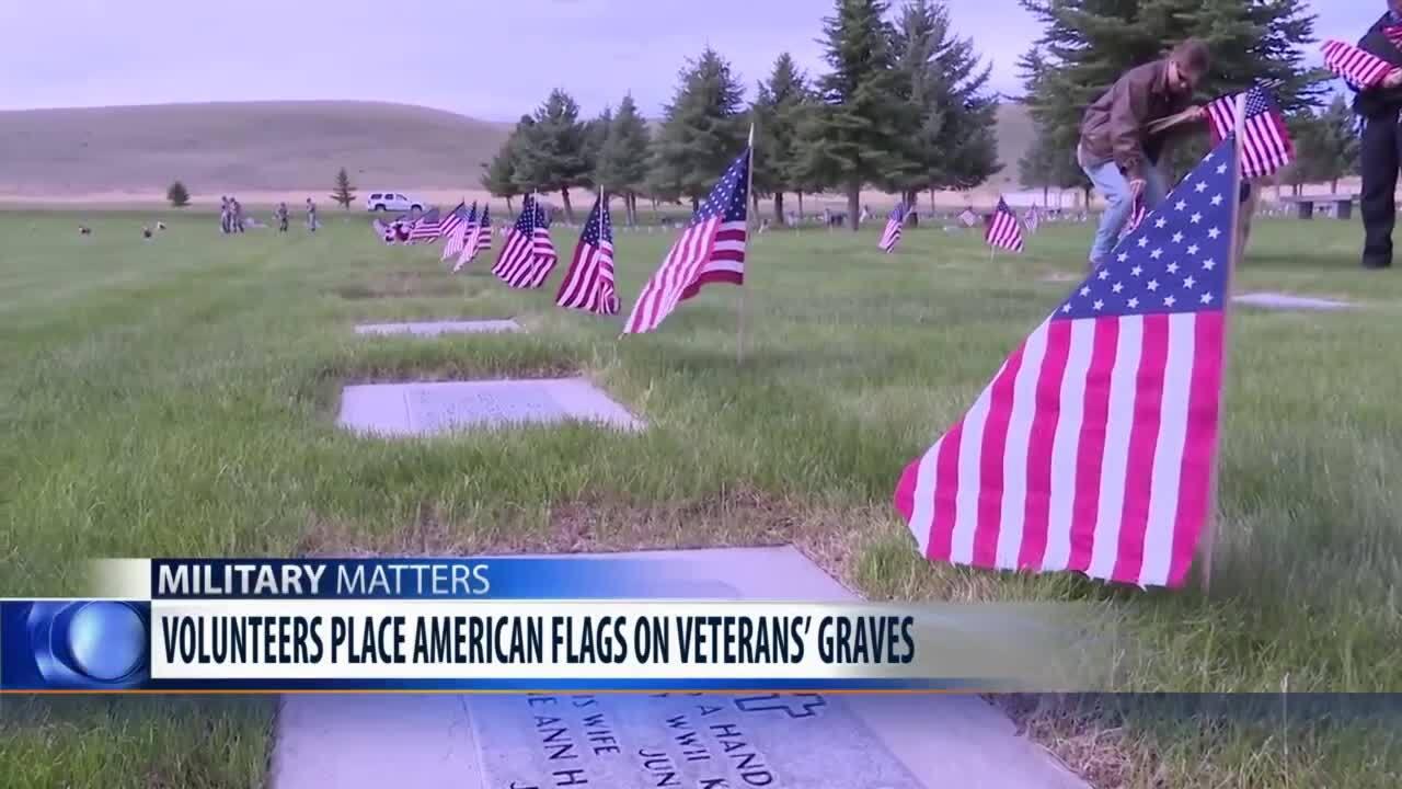 Volunteers flag Montana State Veterans Cemetery