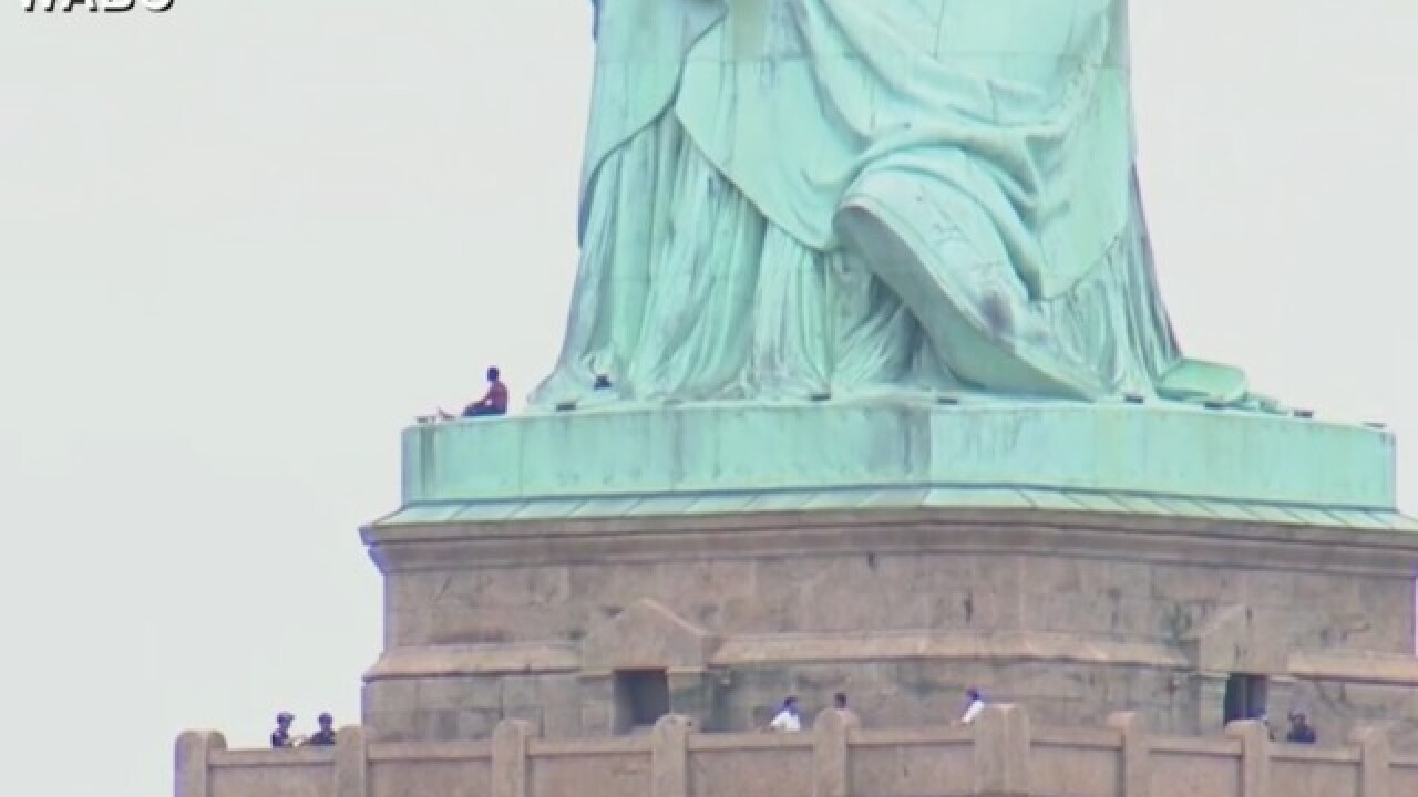 Protester arrested after climbing the base of Statue of Liberty