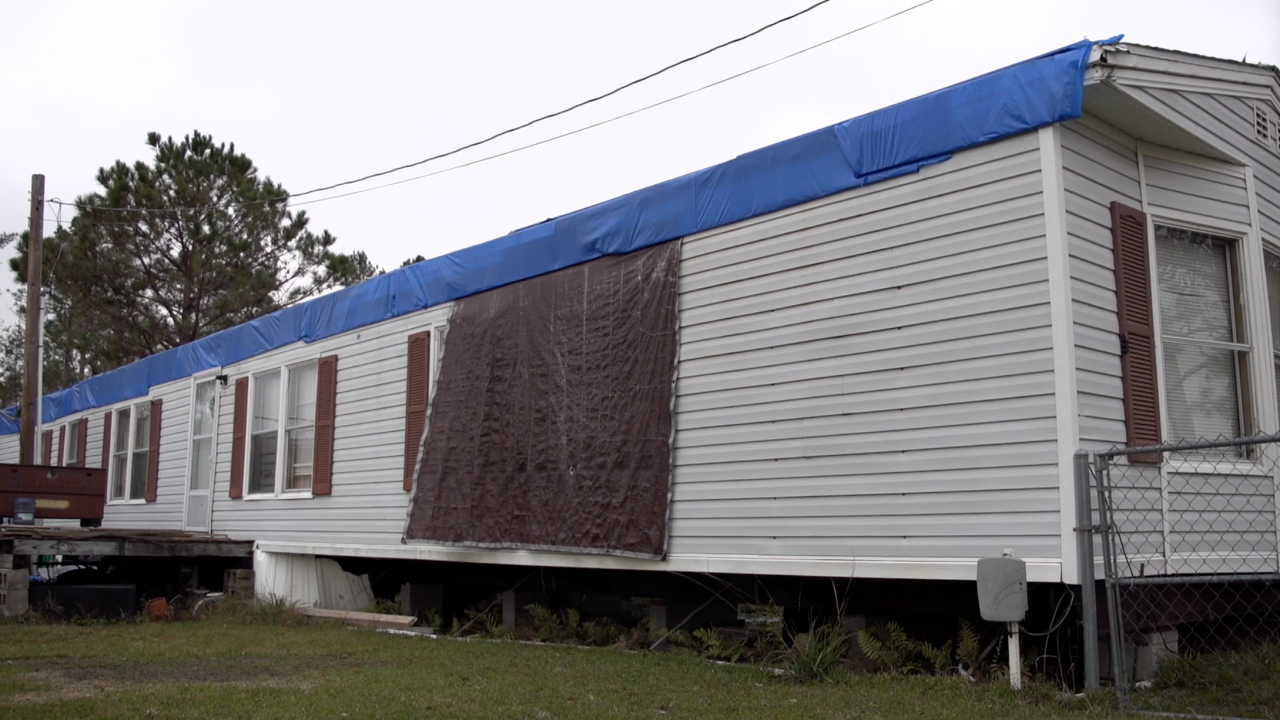 Thousands of homes in southwest Louisiana main covered in blue tarps because of roof damage from Hurricanes Laura and Delta.