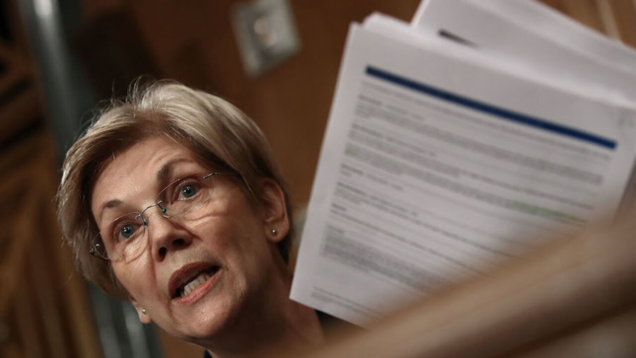 Warren knocks Obama, teases 2020 bid