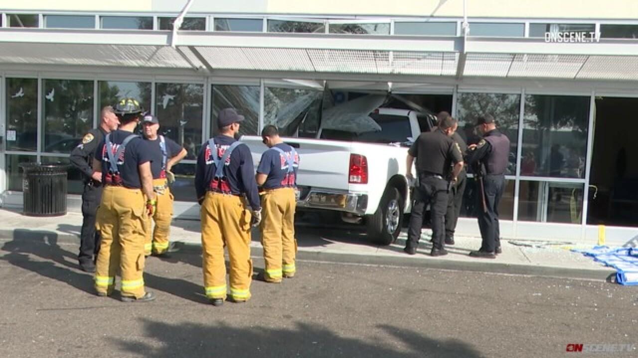Cash flies as truck hits Chula Vista bank