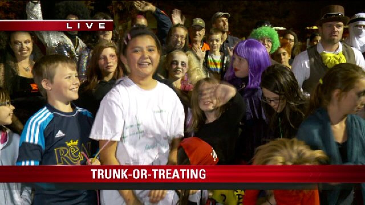 Costumed kids pack parking lot for trunk-or-treat in Taylorsville