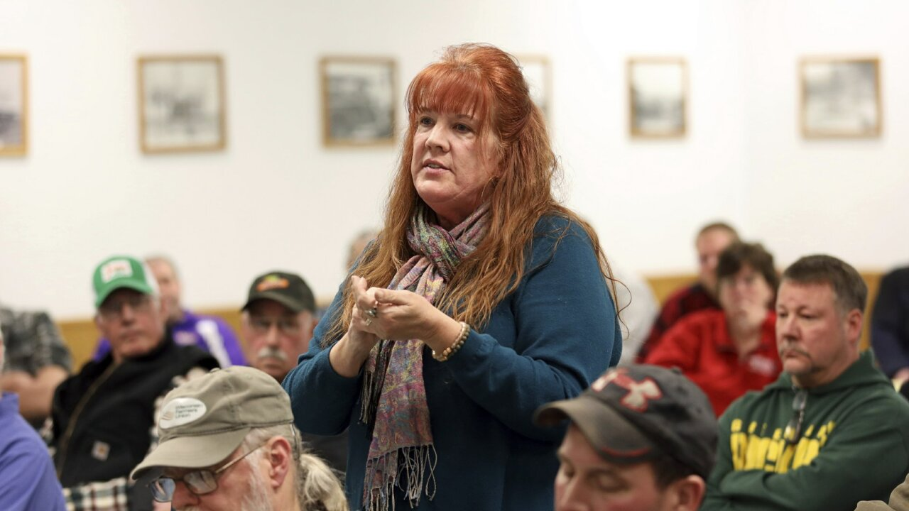 In this Feb. 15, 2019 photo, Cindy Blanc speaks against a the proposed Sugar River Wind Project in the town of Jefferson, Wisc., at a Feb. 28, 2019, town board meeting. Blanc, a town of Jefferson resident, would be able to see turbines from her property. Blanc has worked to organize her neighbors to rally against the turbines. After speaking, Blanc was met with a round of applause from a majority of the more than 70 attendees. (Emily Hamer/Wisconsin Center for Investigative Journalism via AP)