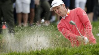 The Latest: Justin Rose birdies last 3 holes to lead US Open