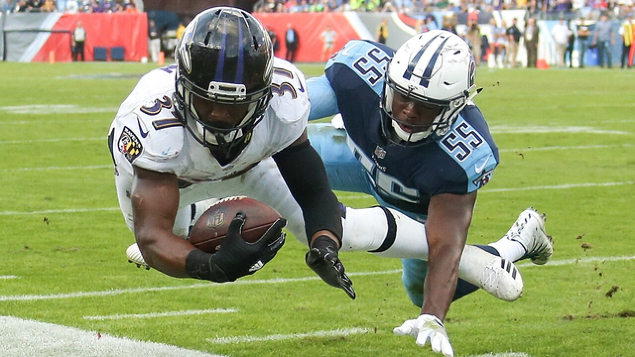 Titans come off bye, win 3rd straight beating Ravens 23-20