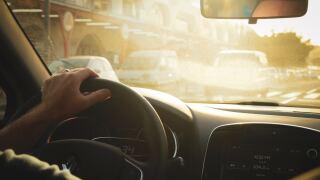 Image of person driving car. Unsplash.com.