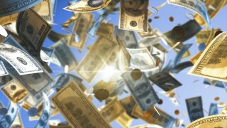 Close-Up Of Currencies Against Sky