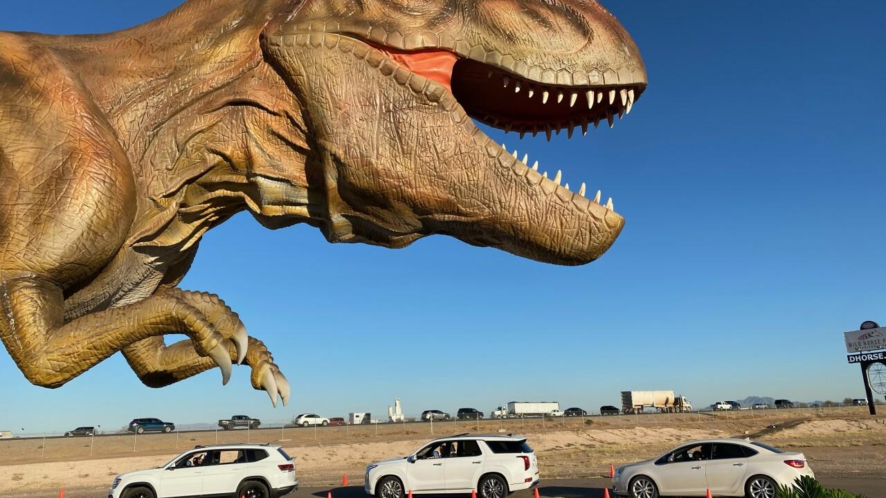 A drive-thru dinosaur exhibit has opened in Chandler