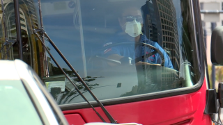 MTS bus driver with face mask