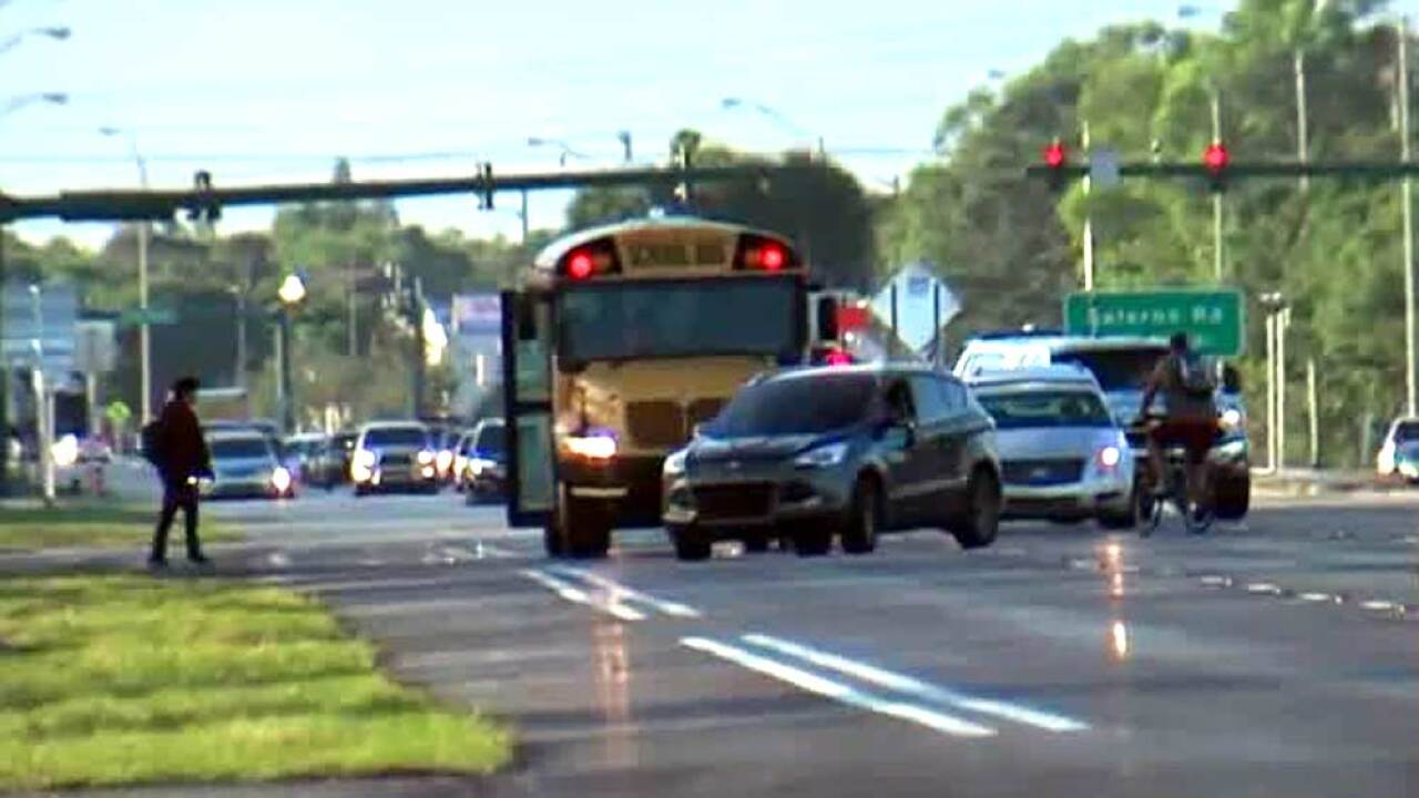 Vehicle goes around stopped school bus