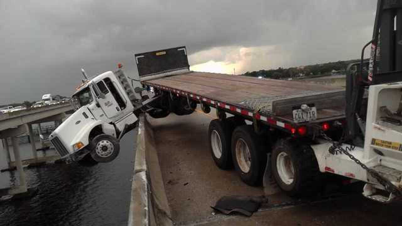 Truck hangs off interstate bridge near Bradenton