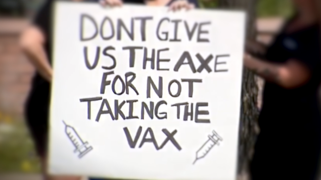 vaccine protest sign.png