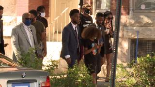 Mayor walks with residents in Mondawmin neighborhood during violent week