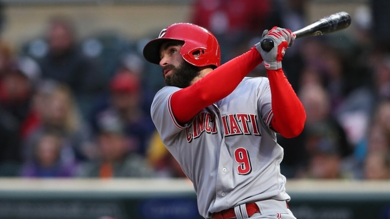 Votto's big night lifts Reds over Twins, 15-9
