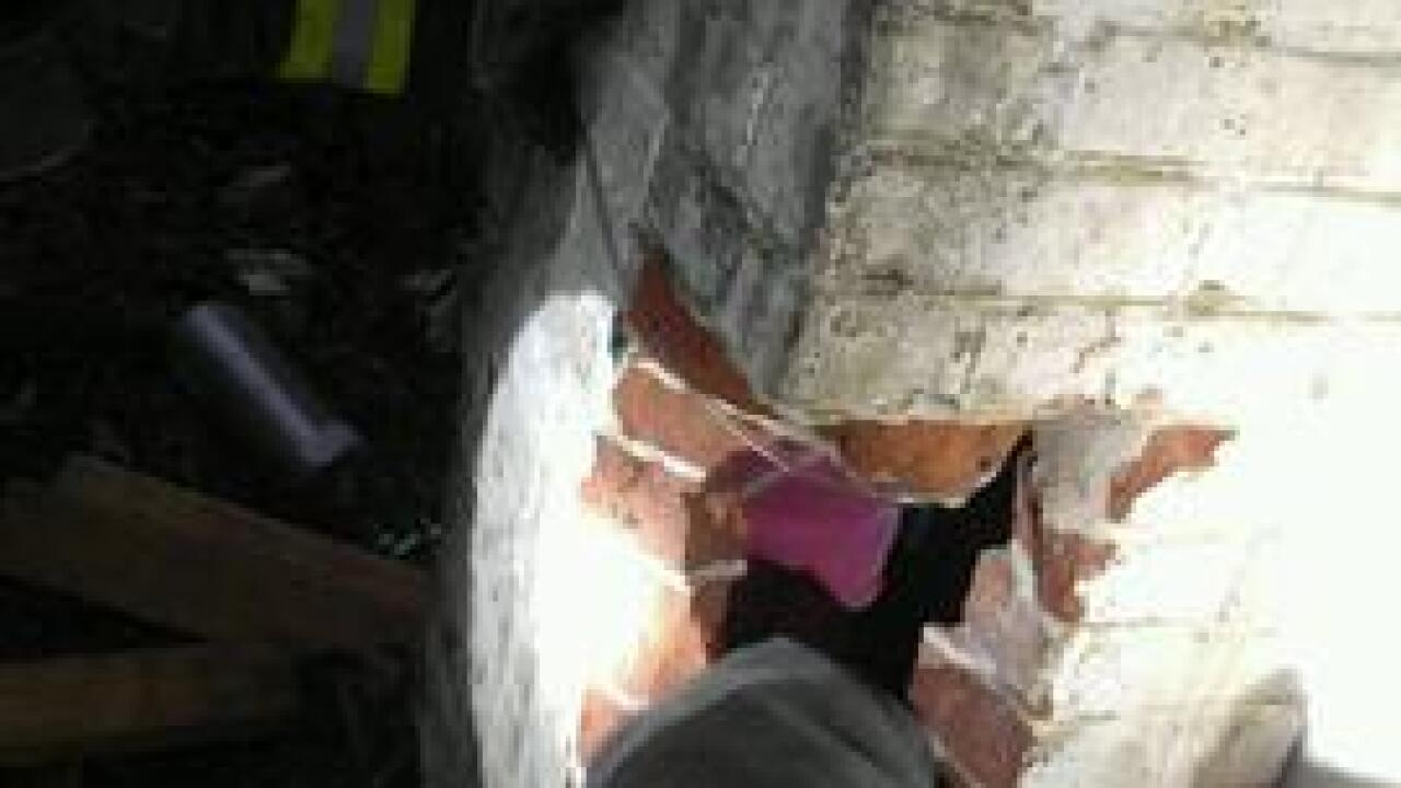 Girl, 8, rescued after getting stuck in chimney