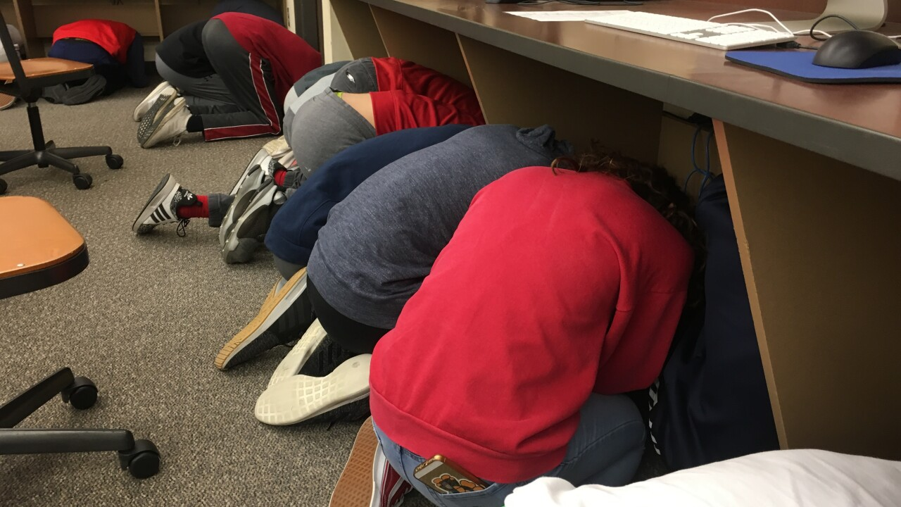 Students at area schools practice what they will do if severe weather strikes.