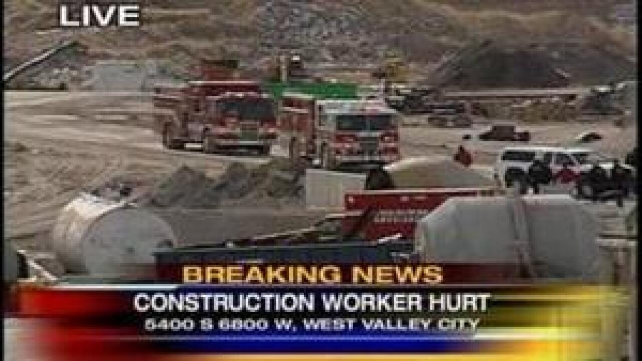 Bulldozer and man fell 40 ft in gravel pit accident