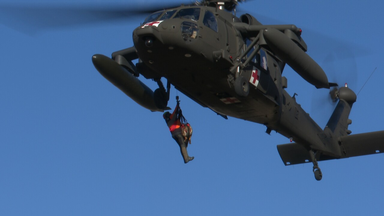 Search teams, dogs practice helicopter hoists at Fort Harrison