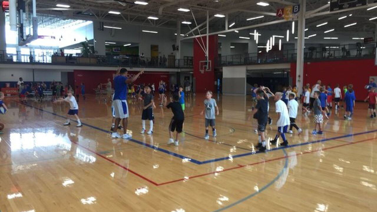 Kids' sneakers squeak at Self basketball camp