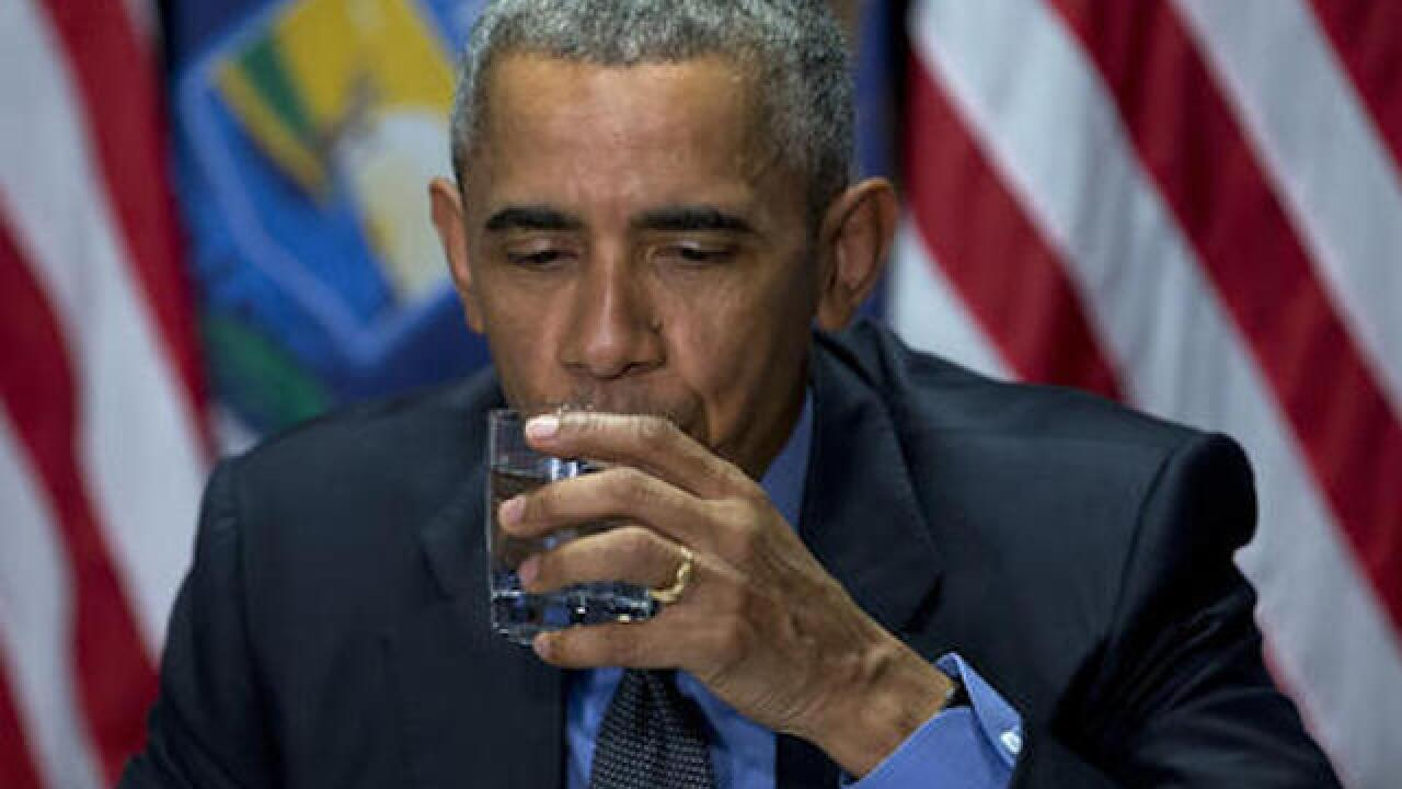 Obama visits Flint, Gov. Snyder booed