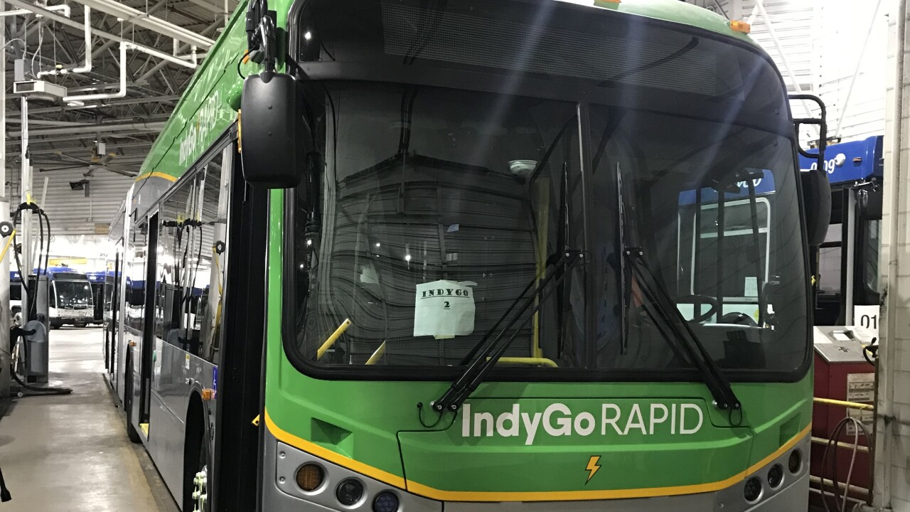 Photos of IndyGo Red Line bus in garage.