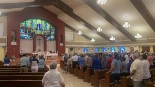 Church goers standing during a mass.