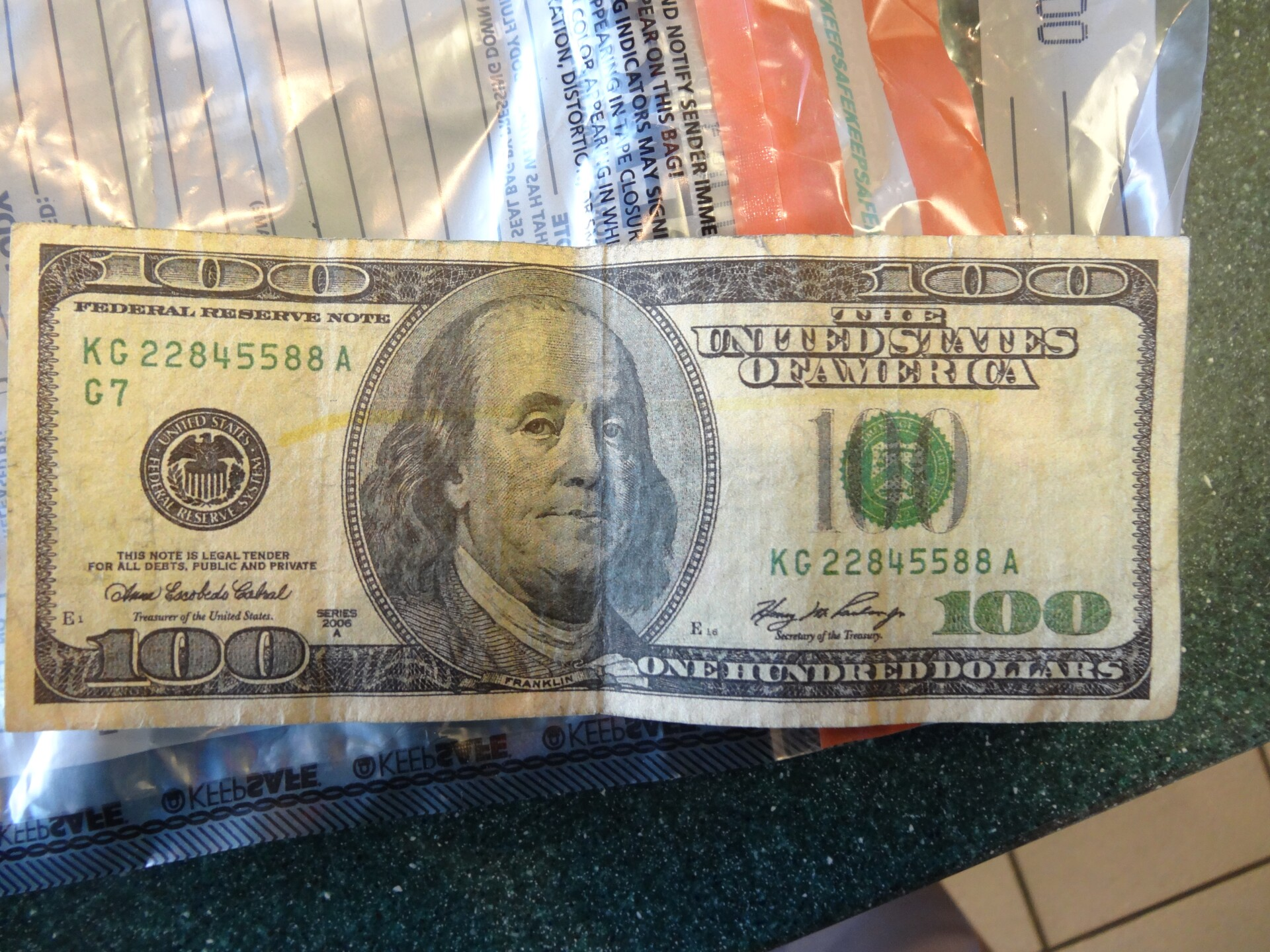 Photos: Employees detect woman using counterfeit $100 bill