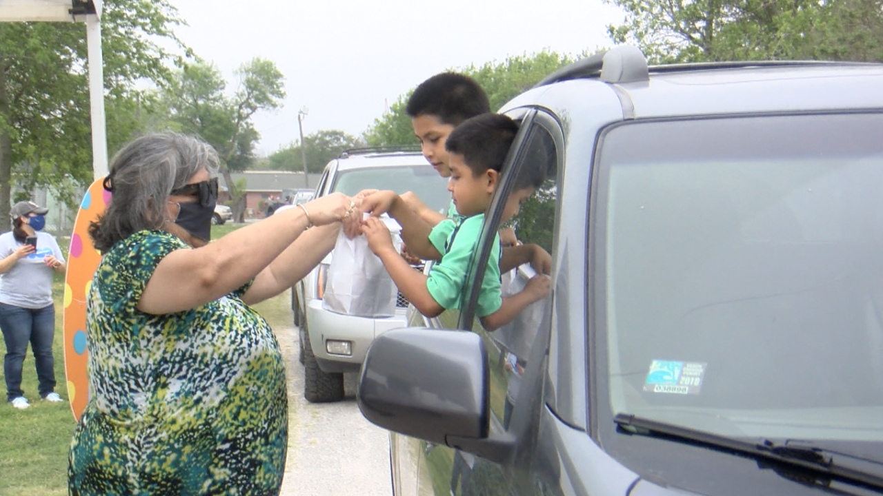 Children over in Gregory receive Easter bags