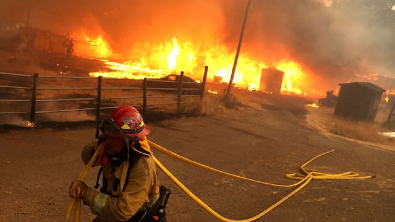 Record-breaking California fire may take until September to contain