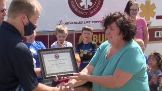 """Michelle Resler presented with a """"life saver"""" certificate"""