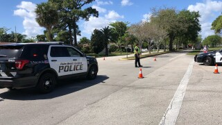 Police block entrance to Palm Beach Gardens Community High School, March 11, 2021
