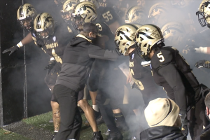 Tim Lester leads Western Michigan out of the tunnel