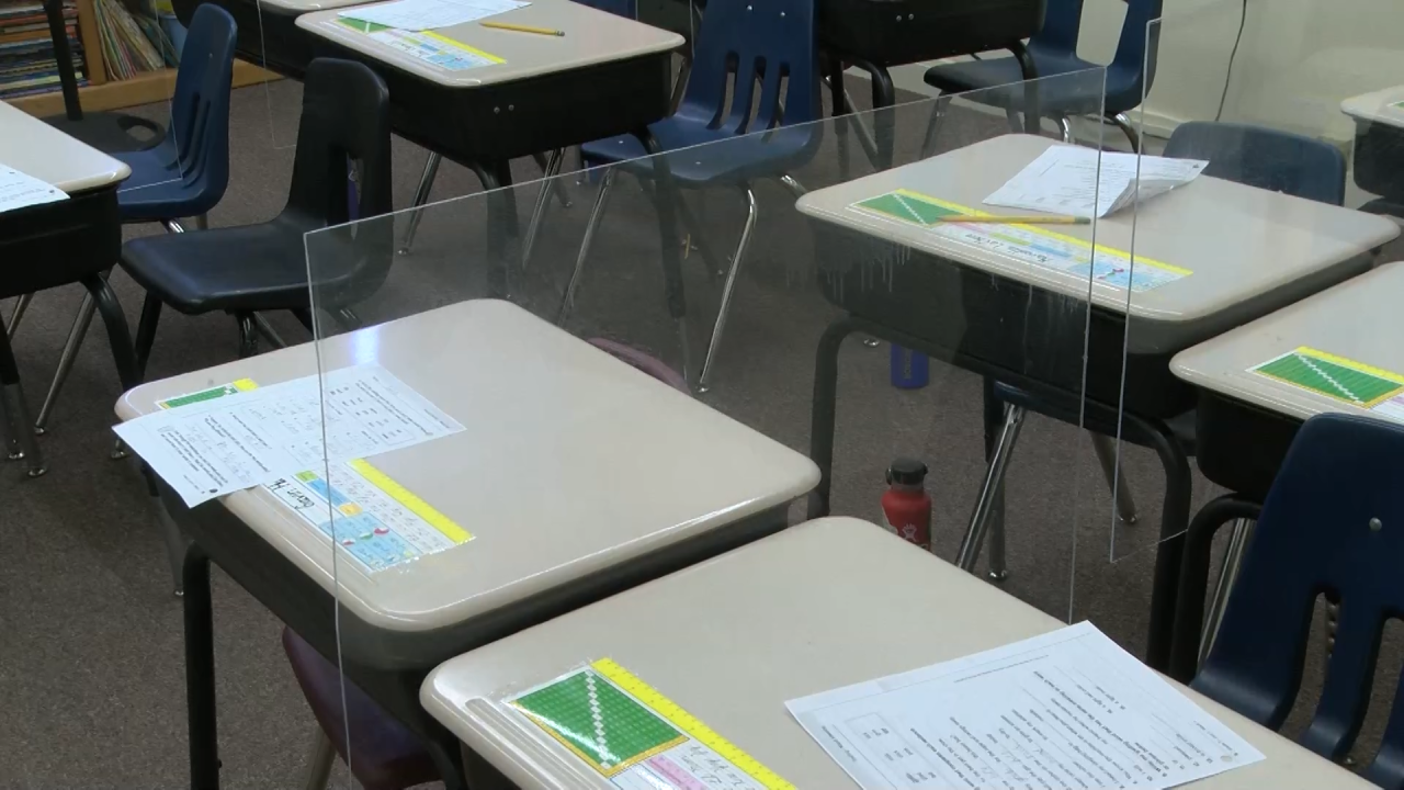 The plastic barriers between the desks were created by a student so that a smaller class room could still be utilized.