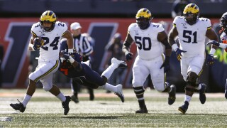 No. 16 Michigan withstands Illinois rally, holds on for win