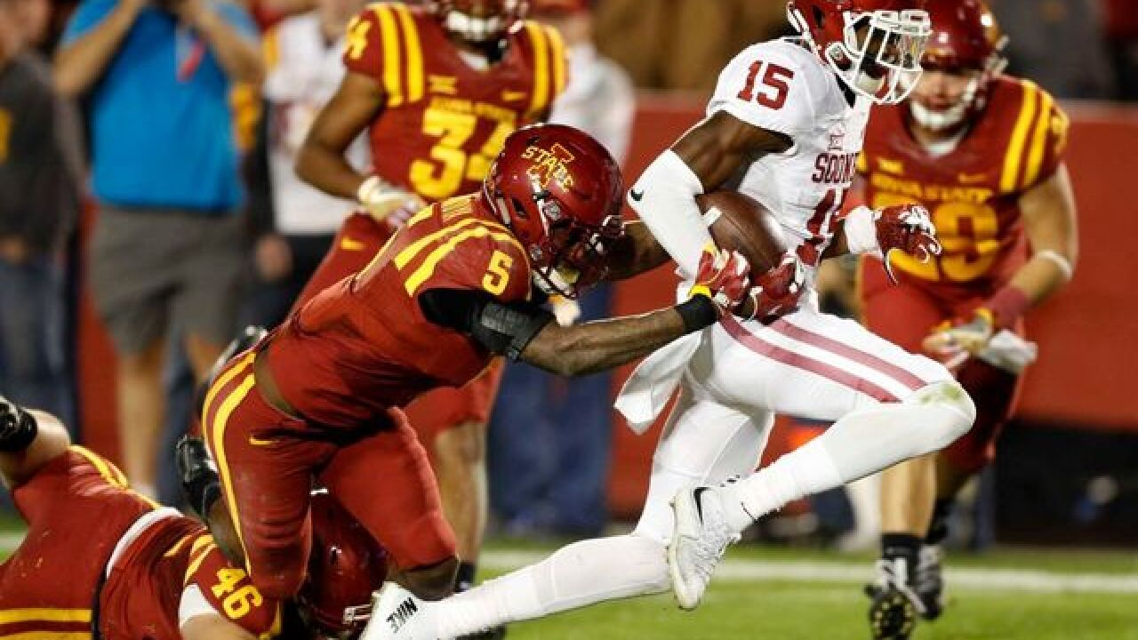 Oklahoma holds off Iowa State, 34-24