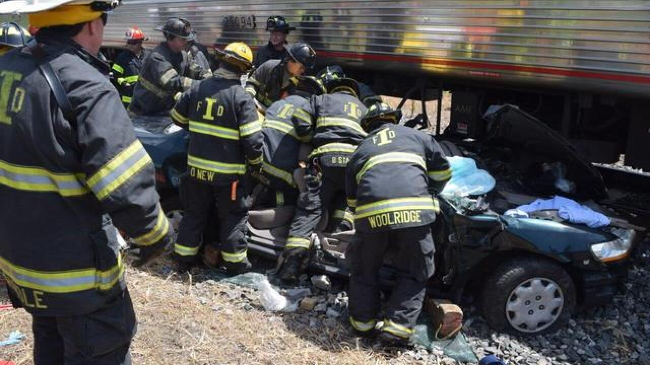 Woman rescued after car hit by train last July
