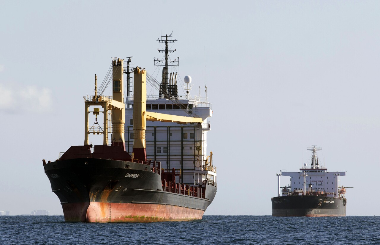 container ship and oil tanker wait to enter Port Everglades in 2013
