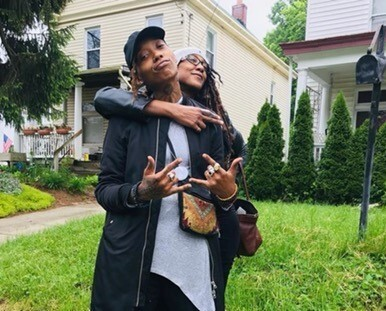 In this undated photo, Siri Imani is wearing a black ball cap and looks directly into the camera. Her mom, Jennie Wright, stands behind Imani. Wright's right arm is hugging Imani from behind as Wright looks off into the distance.