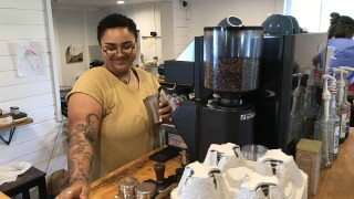Barista brews up coffee at Sawdust Road in the Pungo community of Virginia Beach.