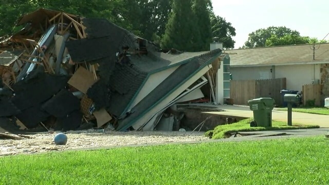 Sinkhole swallows 2 homes, continues to grow in Pasco County