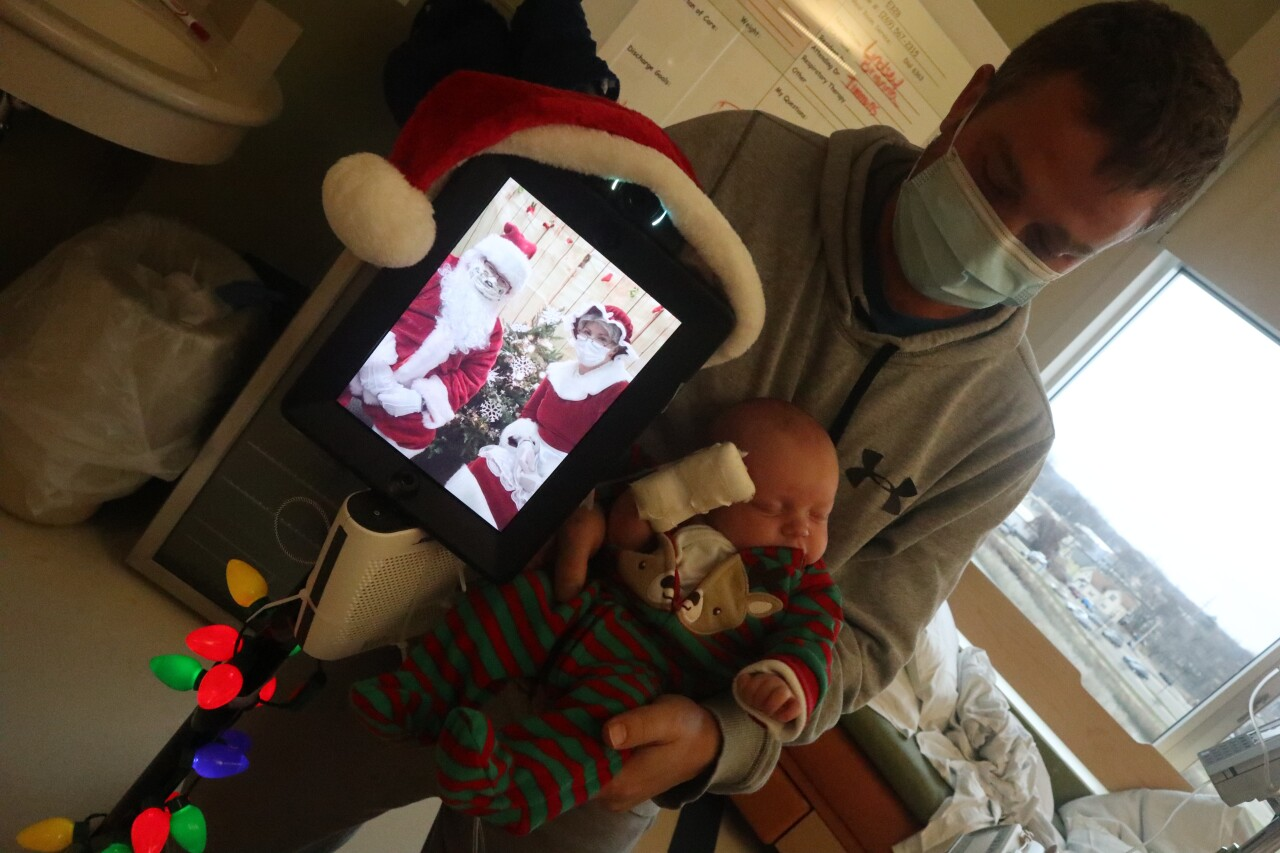First visit with Santa and already using more tech than the parents...