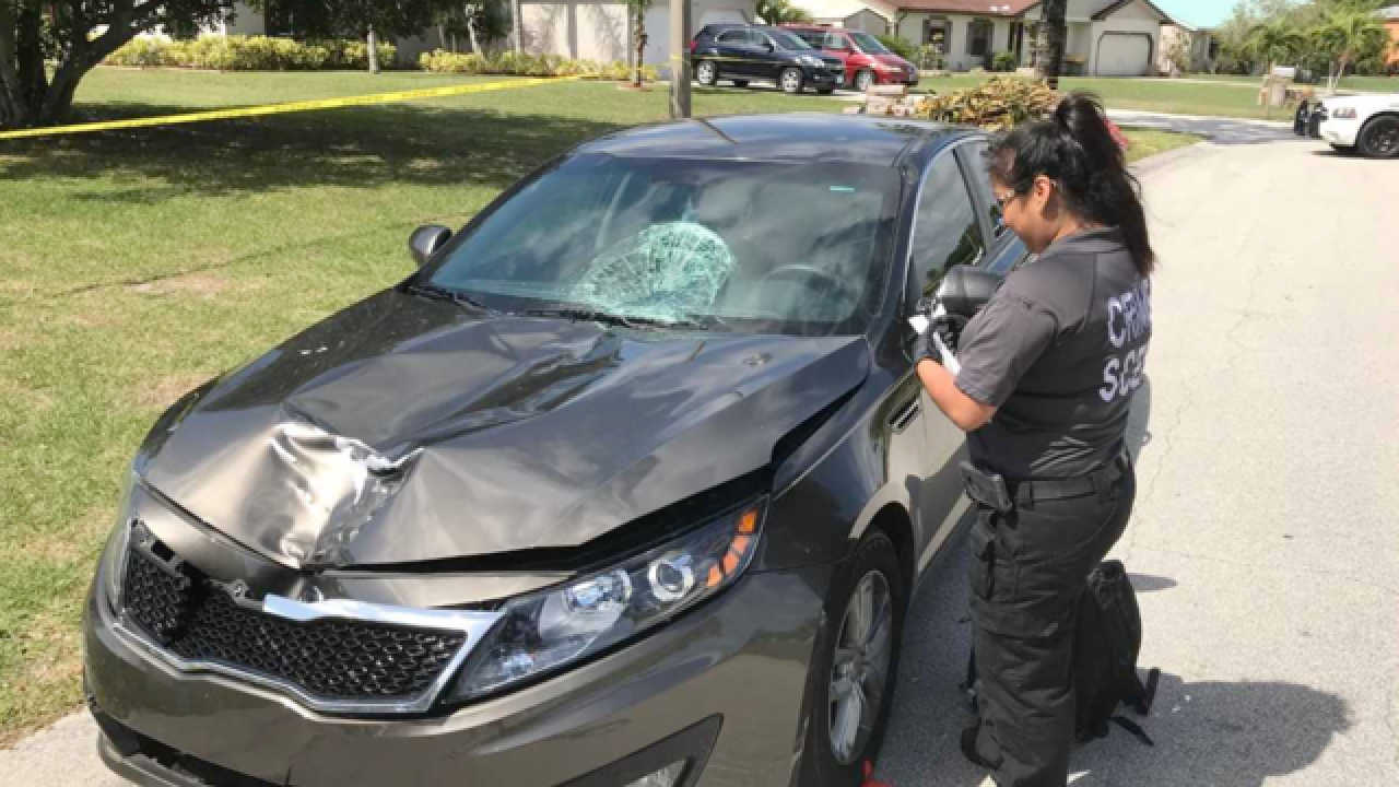 Cops: Woman hits boyfriend with car