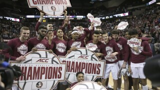 Florida State Seminoles celebrate ACC regular-season basketball championship after Boston College game in March 2020