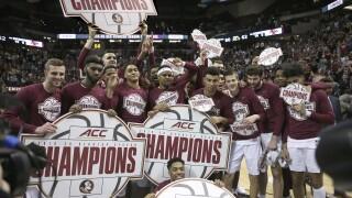 Florida State Seminoles celebrate ACC regular-season basketball championship after Boston College game in March 2020