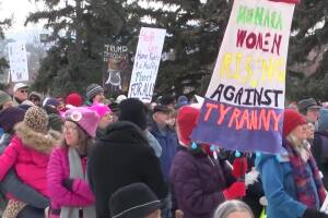 Pink knitted hats and protest signs crowd Memorial Park for 2020 Women's March