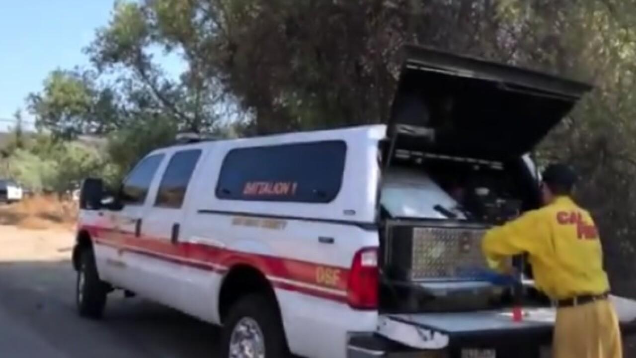 Crews working multi-acre blaze in Fallbrook