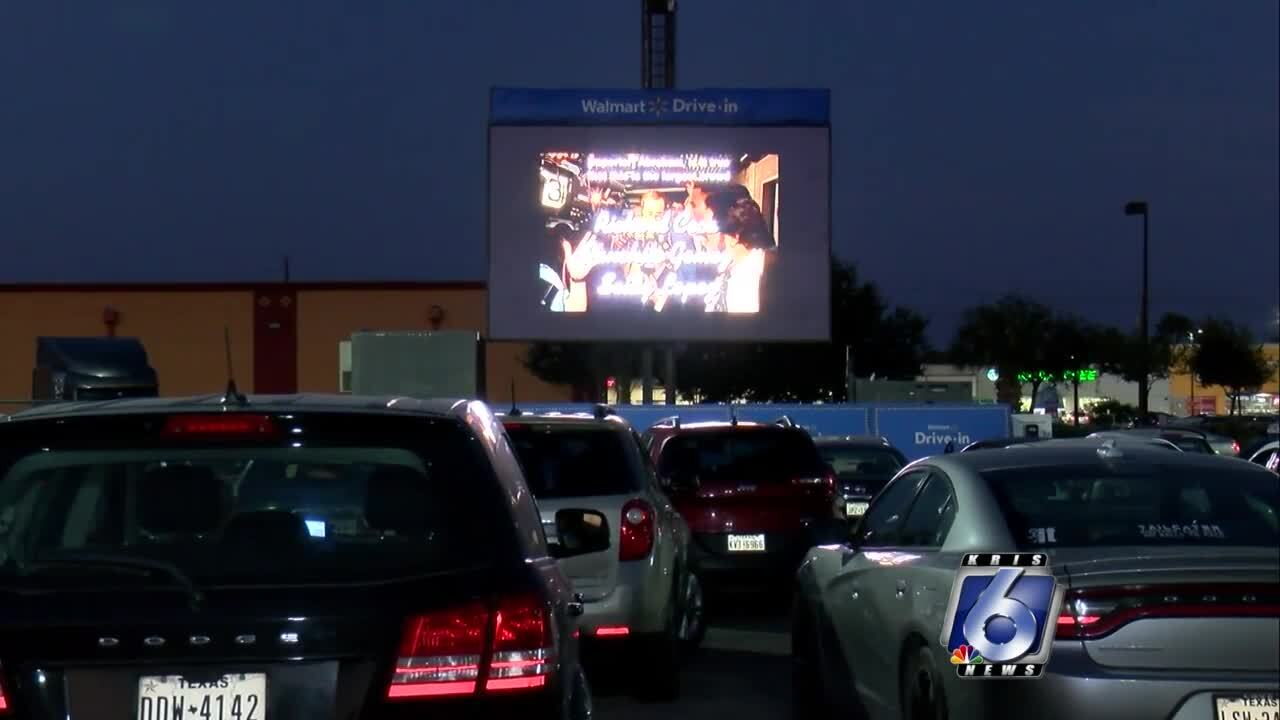 Crowd packs Walmart parking lot for free drive-in movie